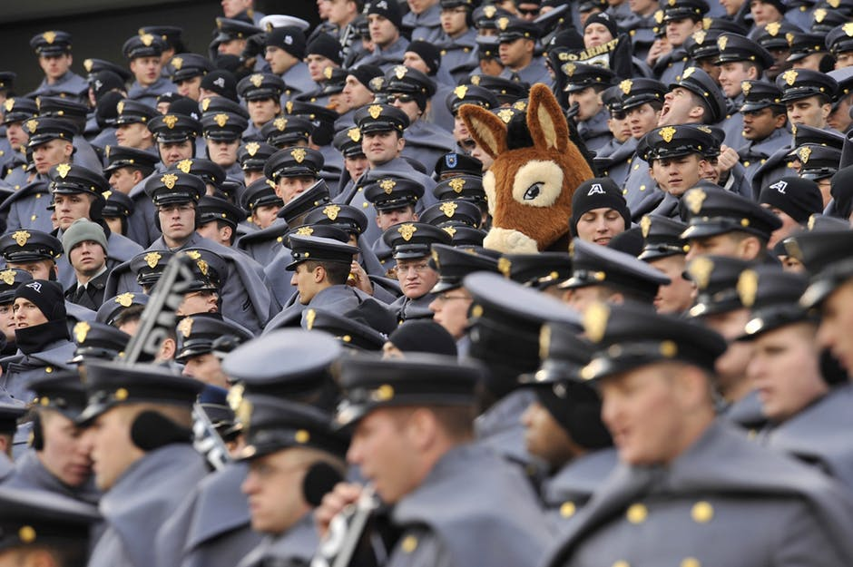 Donkey costume man in a sea of police officers. Why crowd sourced financial logos are a bad idea