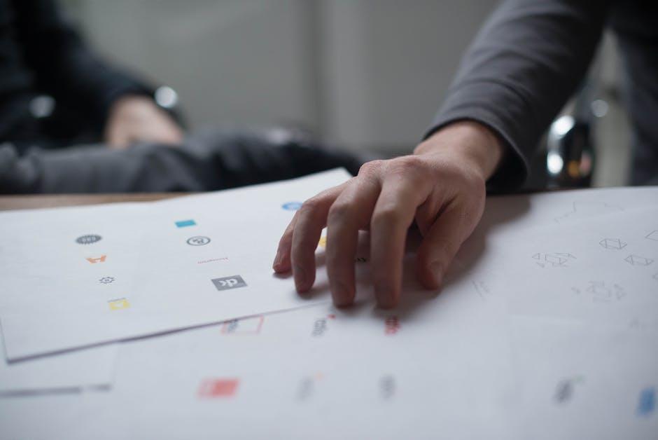 Designer pouring over financial logos ideas