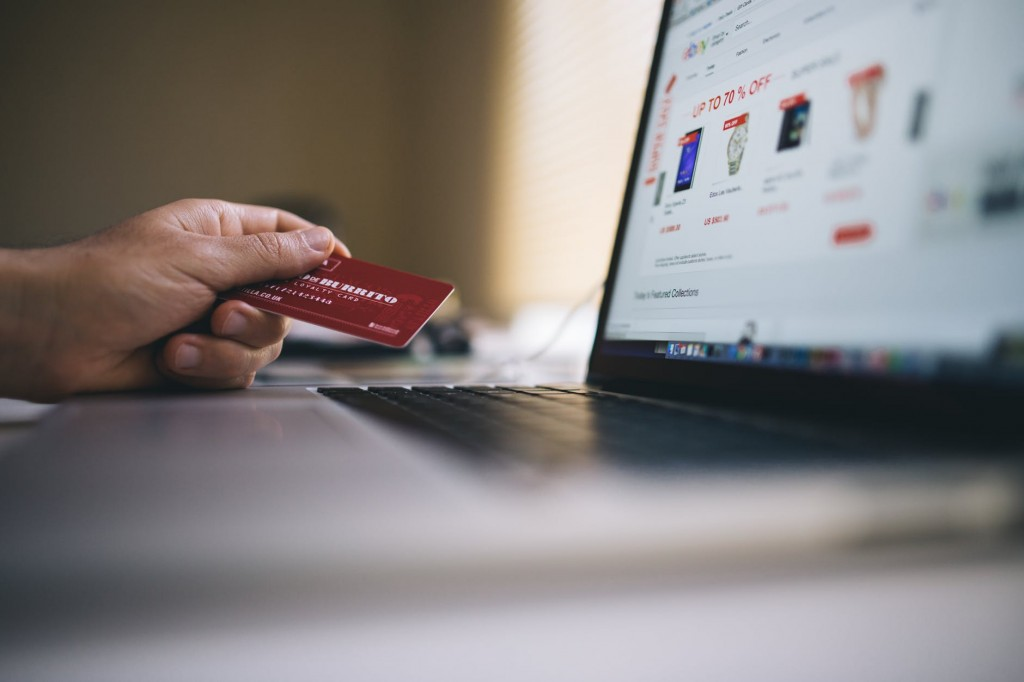 Man using credit card on financial websites