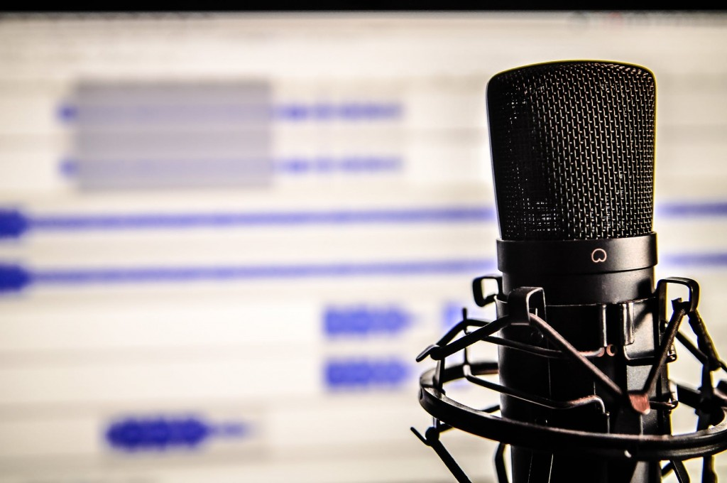 Picture of microphone, financial websites using audio marketing