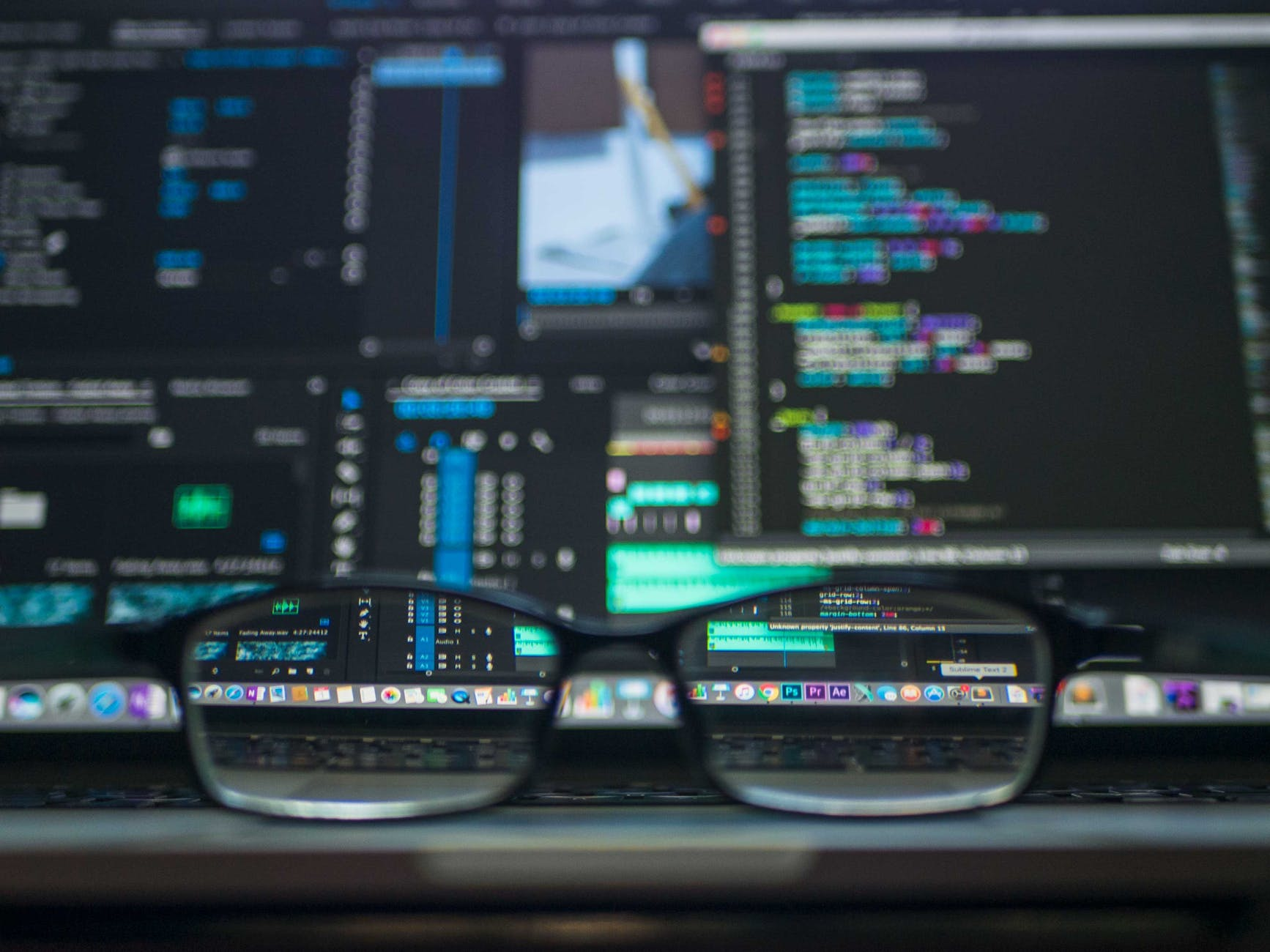 glasses on a computer desk, showing gdpr and financial websites