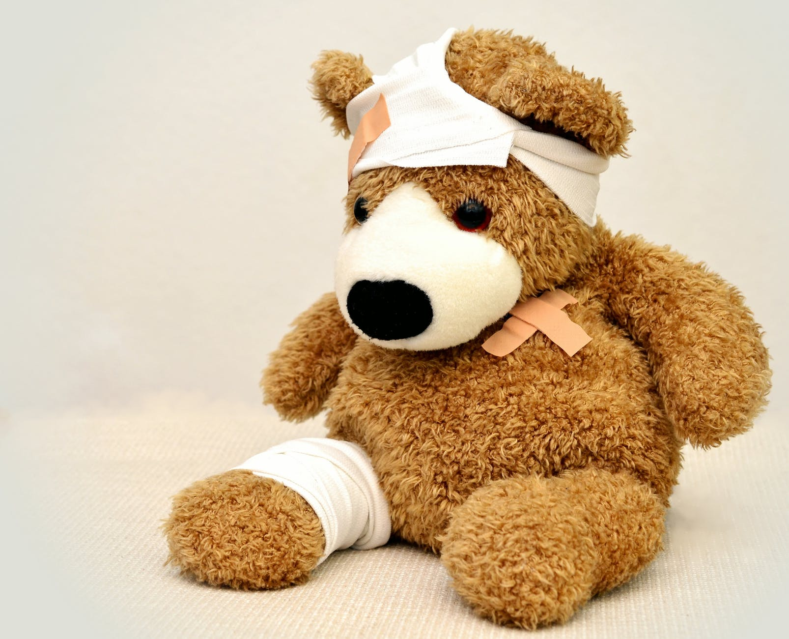 hurt teddy bear, showing how bad SEO can hurt financial websites