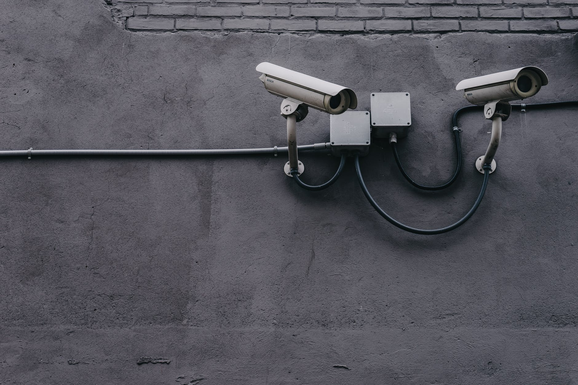 security cameras illustrating a hacker breach in marketing for financial services